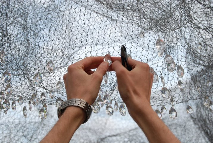 A volunteer attaching the crystals to the wire mesh. Photo by S. Jerrom